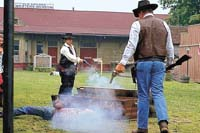 01 Jul 1995, Old Abilene Town, Abilene, Kansas, USA --- Actors portray gunfighters of the old American west, shooting it out in a historical reenactment at Old Abilene Town in Abilene, Kansas. --- Image by © Philip Gould/CORBIS